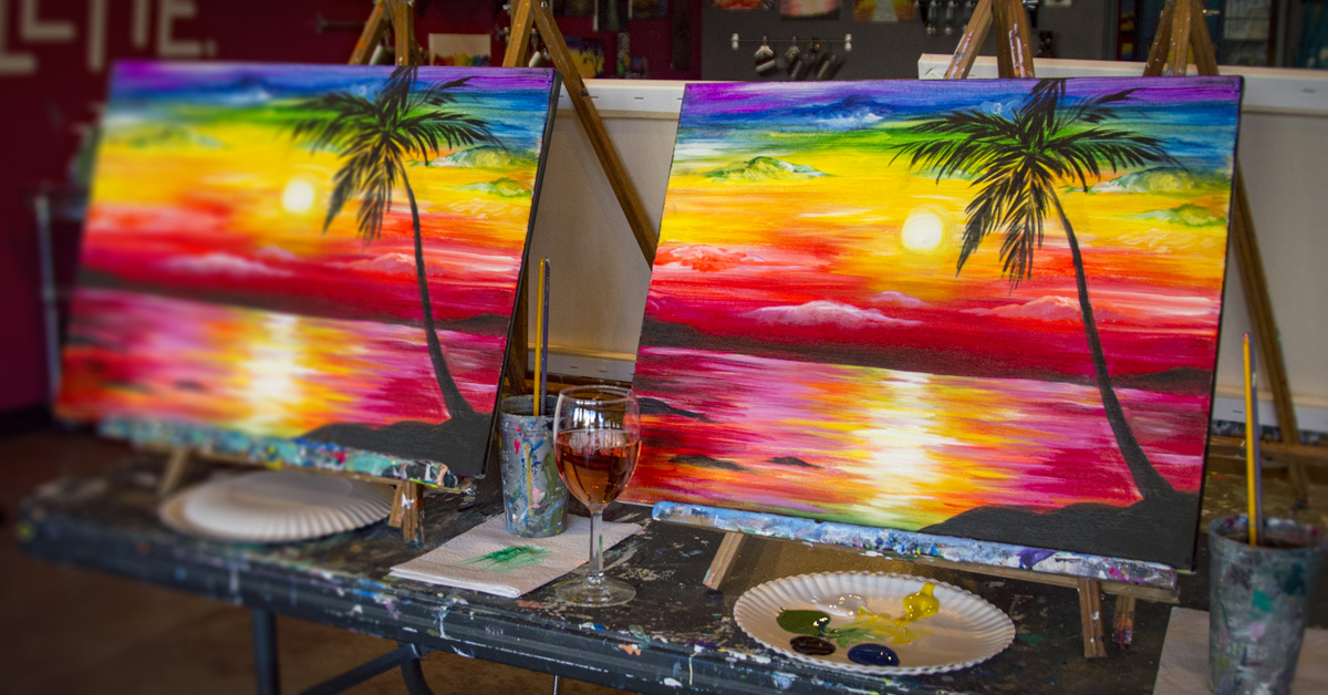 colorful paintings in paint and sip studio