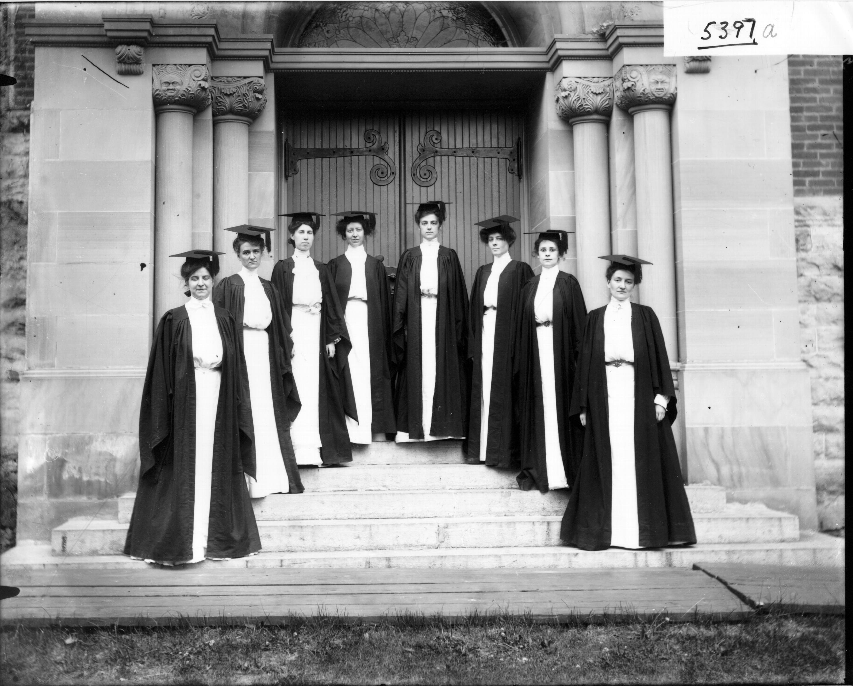 women in cap and gown